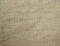 棕色自然纺织品织地不很细背景  免版税库存照片
