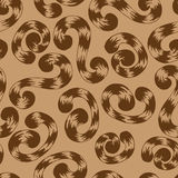 棕色螺纹curlicues的无缝的样式 库存图片
