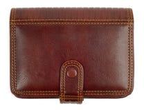 棕色闭合的钱包 免版税库存照片