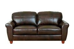 棕色黑暗的沙发 免版税图库摄影