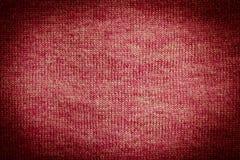 棕色黑暗的织品被编织的红色纹理 免版税库存图片