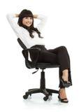 椅子华美的坐的妇女年轻人 库存图片