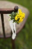 椅子和美丽的小的花 库存图片