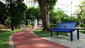 椅子在公园,选择的概念 免版税库存照片