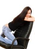 椅子女孩牛仔裤 图库摄影