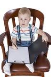 椅子的男孩写道 库存图片