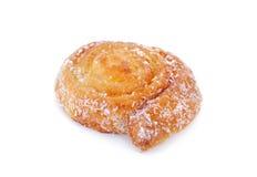 椰子小圆面包在白色背景的卷漩涡 免版税库存照片
