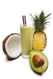 椰子,菠萝,鲕梨汁用牛奶 免版税库存图片