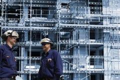 楼房建筑行业工作者 图库摄影