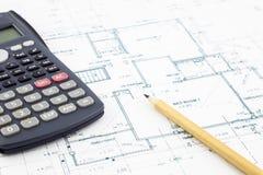 楼面布置图和计算器 免版税库存图片