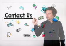概念与我们联系 与黑标志的商人文字在力 免版税图库摄影