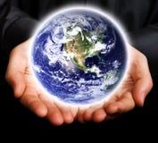 概念地球发光的现有量拯救世界 免版税库存图片