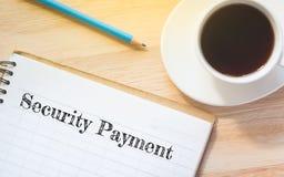 概念安全在书的付款消息 免版税图库摄影