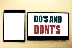 概念性手文字文本说明启发陈列做s并且不Donts 指南的企业概念在tabl准许写 免版税库存图片