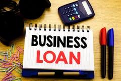 概念性手文字文本说明演艺界贷款 在笔记本书写的借的财务信用的企业概念o 免版税库存图片