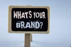 概念性手文字陈列什么是您的品牌问题 企业照片陈列的询问您的公司制造商或m 库存照片