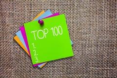 概念性手文字陈列名列前茅100 最佳的产品服务普遍的畅销书企业照片陈列的名单 免版税库存图片