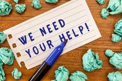 概念性手文字陈列我们需要您的帮助 企业照片陈列的服务协助支持用好处 免版税库存图片