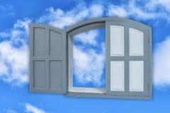 概念性艺术:半开灰色的窗口在蓝天 图库摄影