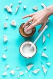 概念有机化妆用品用在蓝色背景顶视图的椰子 免版税图库摄影