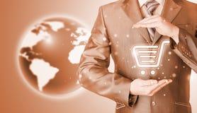 概念消费者玻璃扩大化的保护购物台车 免版税库存照片
