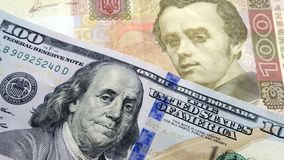 概念货币汇率 乌克兰现金hryvnia和美元美国 库存图片