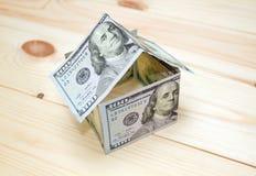 概念费用房主房子图象挣的货币表示 免版税库存图片