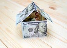 概念费用房主房子图象挣的货币表示 图库摄影