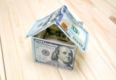 概念费用房主房子图象挣的货币表示 库存图片