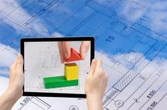 概念建筑手指金子安置关键字 库存图片