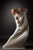 概念 美丽的赤裸女孩打破她的茧 图库摄影
