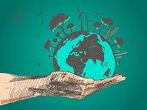 概念绿色世界 地球上的树在手上 免版税库存图片