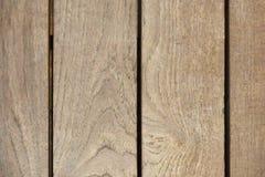 概略的浅褐色的木板条纹理背景 免版税库存照片