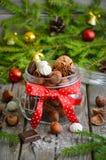榛子和核桃与甜点和香料在一个玻璃瓶子 图库摄影