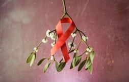 槲寄生和磁带艾滋病,红色丝带, 库存照片