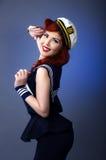 模型的Pin在蓝色背景隔绝的水手服装 图库摄影