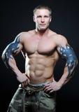 模型肌肉的纹身花刺 库存图片