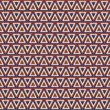 模式无缝的三角 在蓝色和红颜色的几何背景 免版税库存图片