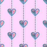 模式无缝的向量 与五颜六色的装饰心脏的对称背景在桃红色背景 免版税库存图片