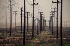 横渡一个领域的输电线在Ptolemaidaa希腊 图库摄影