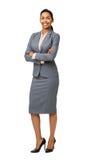 横渡的微笑的女实业家常设胳膊画象  免版税库存图片