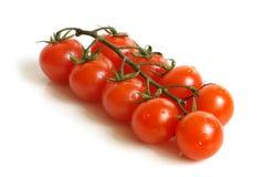 樱桃包括下落蕃茄 免版税库存图片
