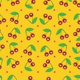 樱桃的样式在黄色背景的 免版税库存照片