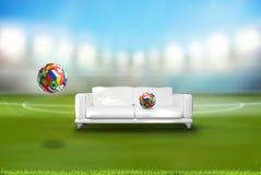 橄榄球与各种各样的国家的足球有长沙发的在体育场内 库存图片