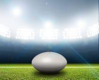 橄榄球体育场和球 图库摄影