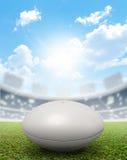 橄榄球体育场和球 免版税库存图片