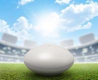 橄榄球体育场和球 库存照片