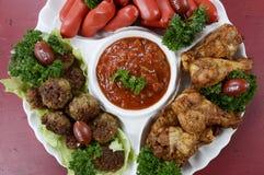 橄榄球党食物盛肉盘 库存图片