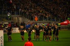 橄榄球卡托利卡比赛所有黑的意大利- 免版税库存图片