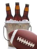 橄榄球和啤酒在桶 库存图片